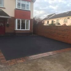 Tarmac driveway with rustic border